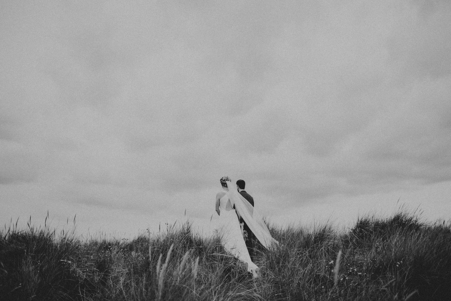 Bride and groom on norfolk dunes