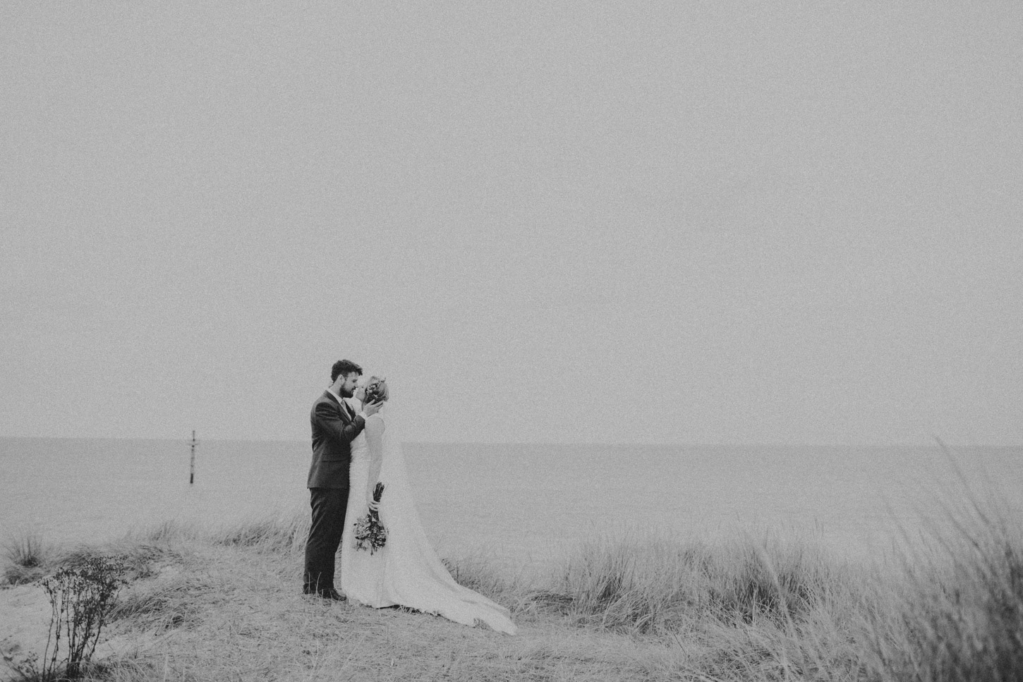 black and white image of Bride and Groom in Dunes by Tori Hancock Photography