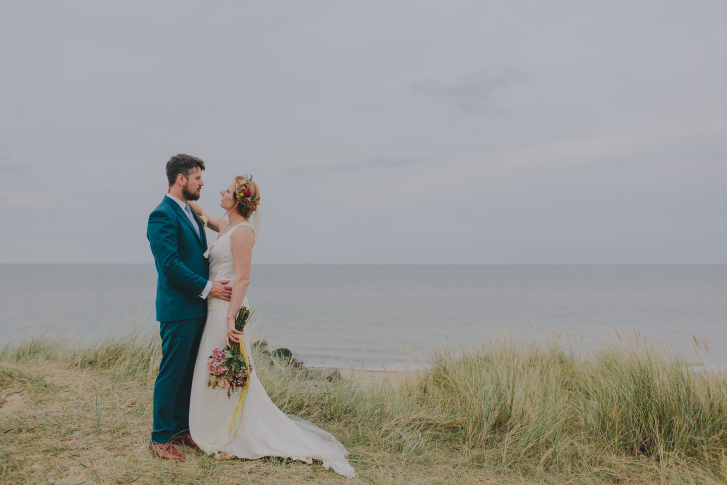 Bride and groom with a sea view