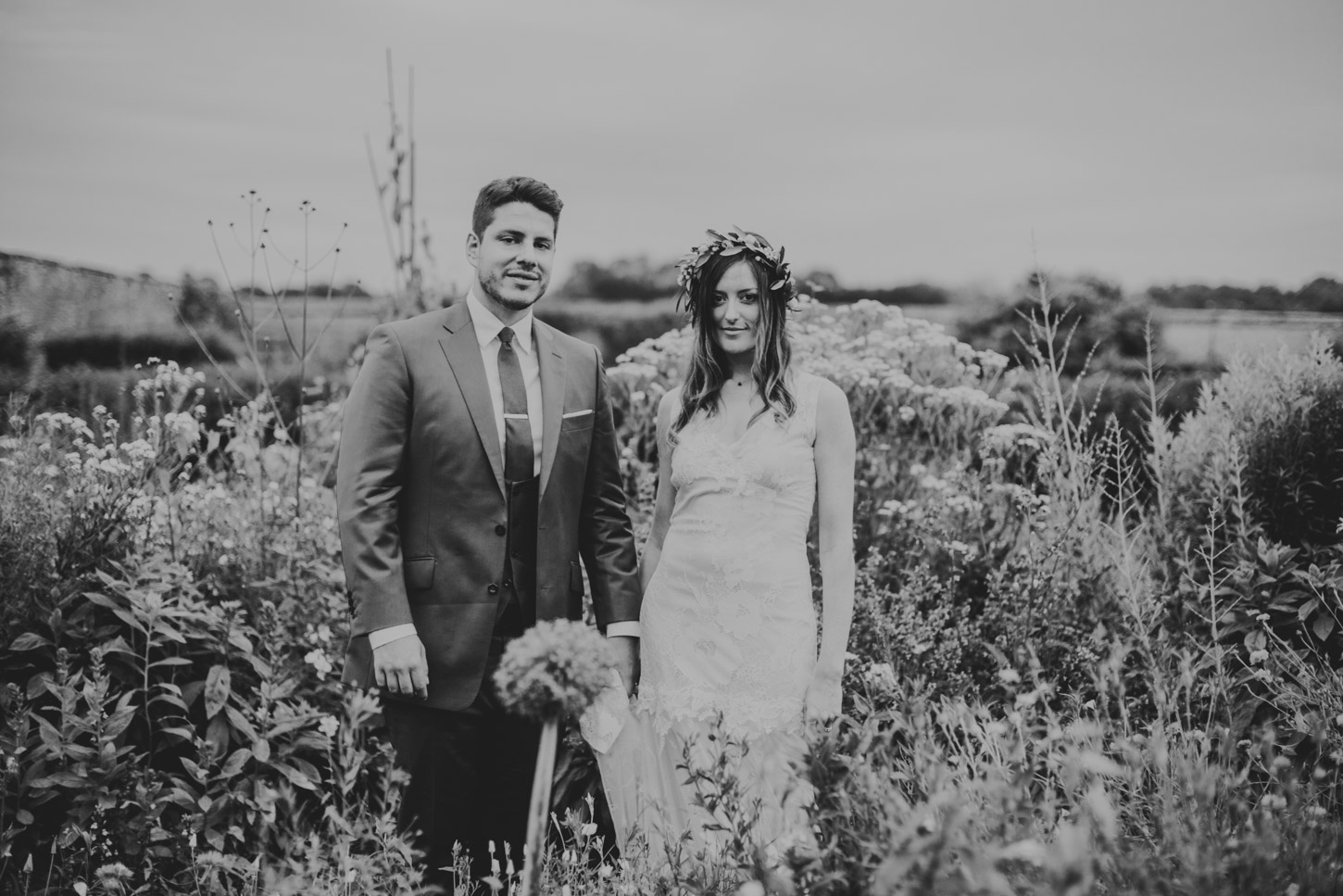 black and white image of bride and groom in garden