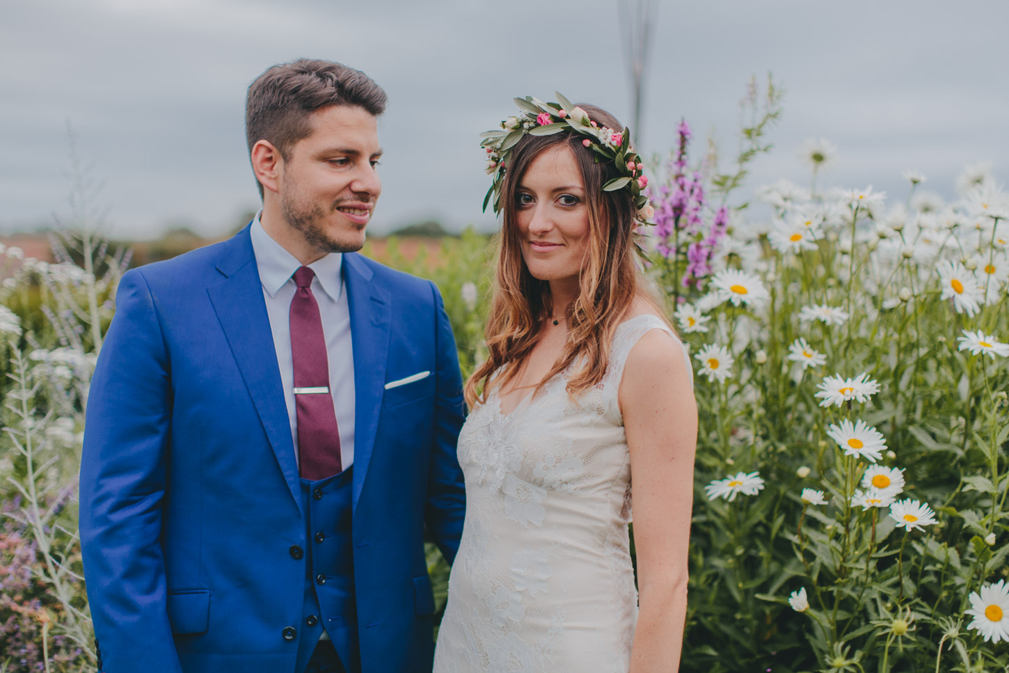 bride and groom in english flower garden